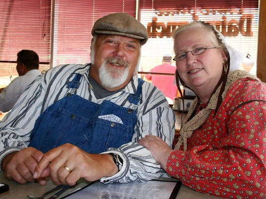 Champoeg volunteers Mark and Donna Hinds, dressed in period garb, stopped by Holding Court at the Court Street Dairy Lunch on Tuesday to promote an historical tour with period re-enactments coming up June 20 at two cemeteries in the Mid-Valley.