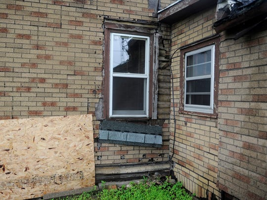 A house on the corner of 14th Ave. S shows damage on the exterior, the St. Cloud City Council will vote on Monday wether to demolish it. The house has missing windows, paint, and damage to the foundation.