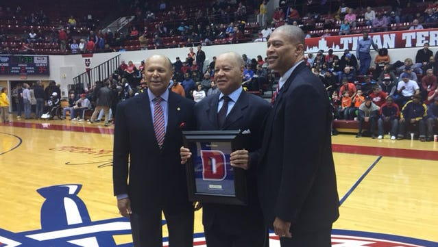 Perry Watson, center, was honored at the Detroit Mercy basketball game against Wichita State.  UDM President Dr. Antoine Garibald, left, and athletic director Robert Vowels helped in honoring the basketball coach.