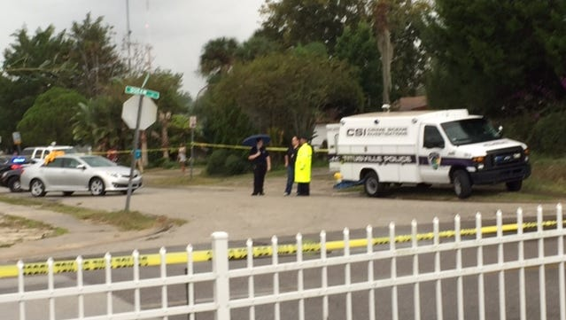 Titusville police at the scene of a shooting on Queen Street on Saturday, Nov. 21, 2015.
