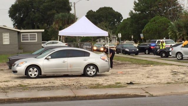 Police investigate a shooting in Titusville near Deleon Avenue on Saturday, Nov. 21, 2015.