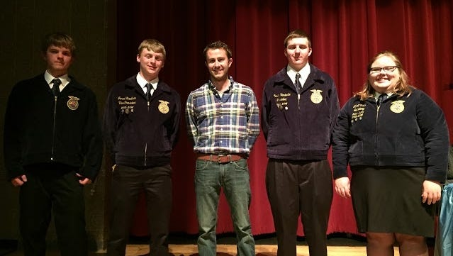 The Southern Door FFA presented Jacob Brey with the Distinguished Service Award during its annual awards banquet. Brey provided valuable coaching to the FFA's dairy judging team. The team took sixth place out of more than 40 teams and received a team gold. The FFA team is, from left, Nathan Lenius, Jared Bauhuin, Brey, Austin Vandertie, and Marti Viste.