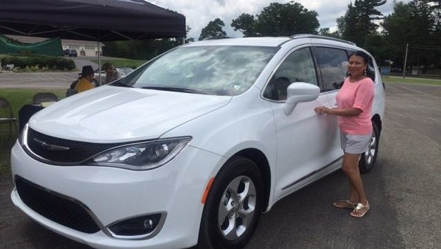 A woman gets set to take a test drive in a Booster Club fundraiser for Athens High School, co-hosted by Brickner Motors, Inc.