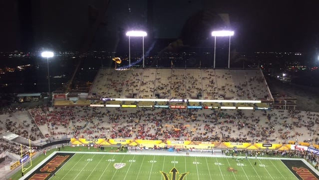 Members of the Golden Knights, an Army parachute team, descend into Sun Devil Stadium on Thursday night before ASU hosted Utah.