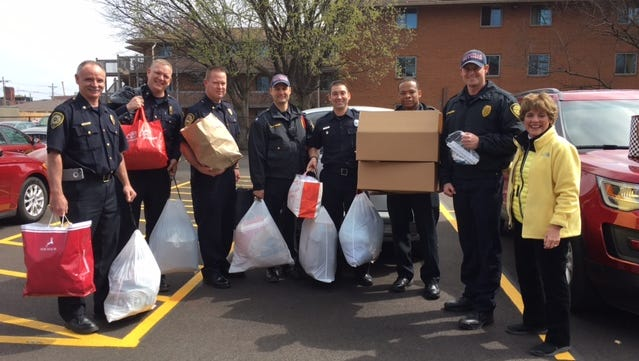 Col. Douglas V. Recktenwald, Executive Assistant Chief (second from left) and his team at the Louisville Fire Department Headquarters helped collect items for the Love From Louisville refugee relief effort with Lynne Meena Rapp.