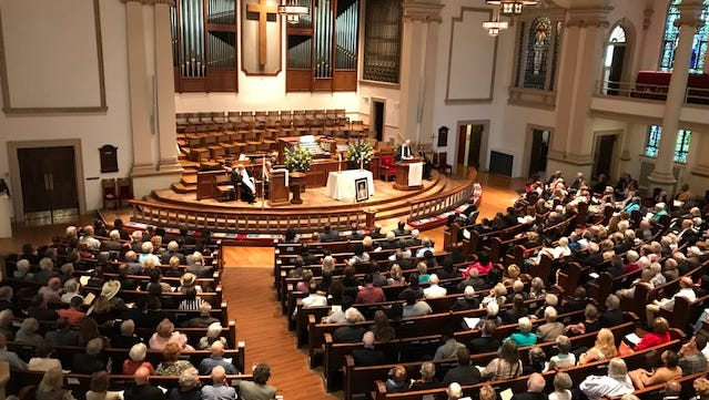Friends, family and admirers attend a memorial service at the Belmont United Methodist Church on Sept. 2, 2017 in celebration of the life of The Rev. Bill Barnes.