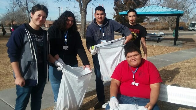 New America School students Bailey Thomas, from left, Shelsea Benitez, Luis Gonzalez, Joel Craig and William Horner pick up trash and debris at Apodaca Park as part of the school's MLK Day of Service on Monday, Jan. 15, 2018.