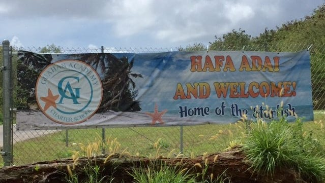 "A ""Hafa Adai"" and ""Welcome"" sign by the entrance to Guahan Academy Charter School's new campus at Tiyan is photographed on Friday, Feb. 9, 2018."