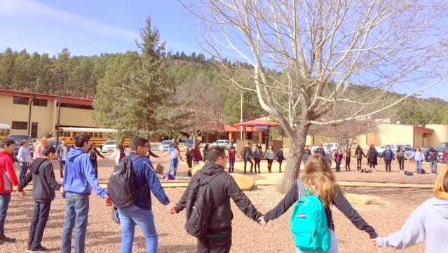 More than 85 students at Ruidoso High School observed a 17 minute tribute of silence for Marjory Stoneman Douglas shooting victims in Florida.
