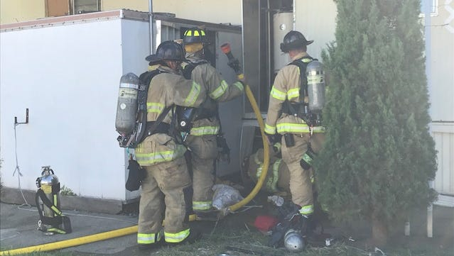 Redding firefighters check on a water heater that caught fire Wednesday, June 13, 2018 at a mobile home park on Twin View Boulevard.