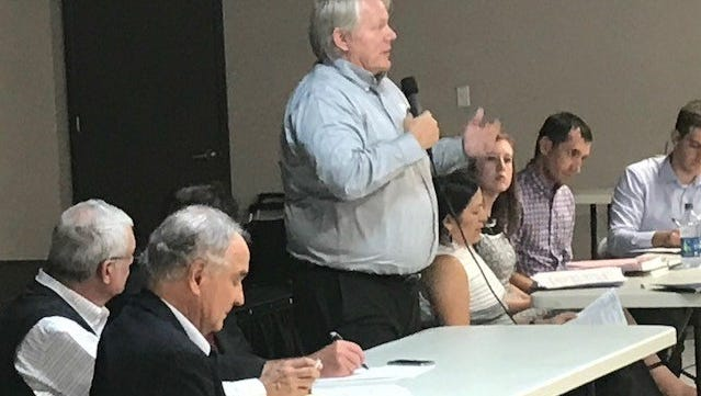 Bruce Broberg, director of Air Quality Markets, answers questions from McCulloch County residents Thursday, June 21, 2018, at the ED Civics Center in Brady.