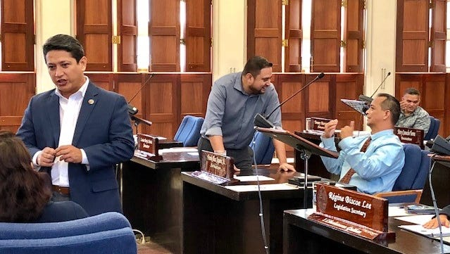 From left, Sens. Wil Castro, Fernando Esteves, Frank Aguon and Tommy Morrison confer with their colleagues right before the start of a 4 p.m. Wednesday special session that Gov. Eddie Calvo called to take up his new bill amending the 2 percent sales tax law to help Guam Memorial Hospital with its Medicare funding and accreditation.