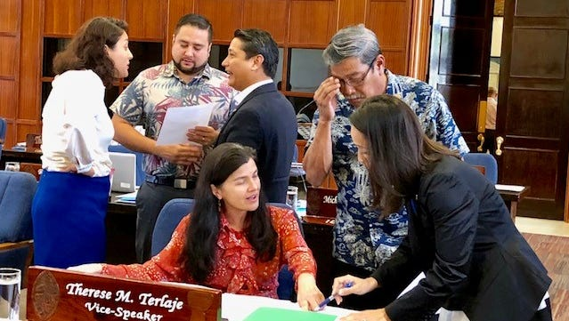 Senators on Monday morning confer with each other during a short session break to clarify language and amendments to Sen. Tom Ada's Bill 154, which seeks to upgrade Guam's sign law to, among other things, allow digital billboards and off-premise signs.