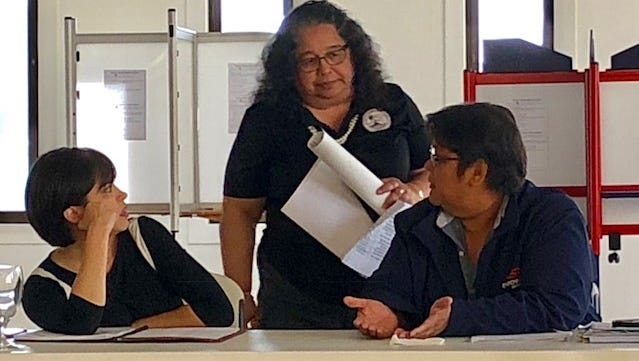 Guam Election Commission Executive Director Maria Pangelinan, center, confers with Commissioner Jadeen Tuncap and Chairwoman Alice Taijeron, right, during an Aug. 6 meeting.
