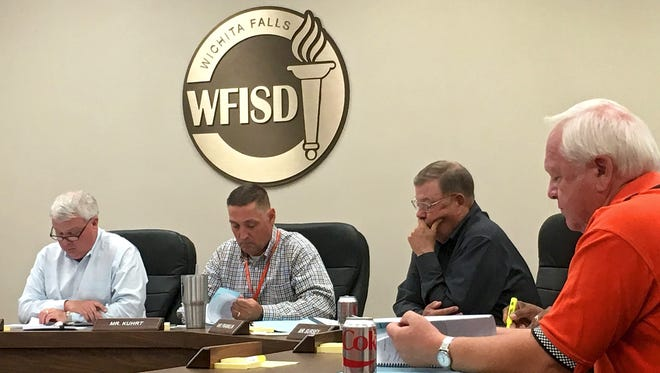 Members of the Wichita Falls ISD Board of Trustees and Superintendent Michael Kuhrt listen to information presented at a work session on Sept. 12 at the WFISD Education Center.