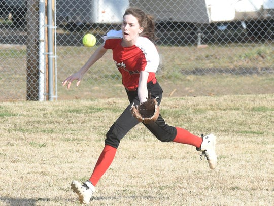Norfork's Marleigh Dodson runs down a fly ball against