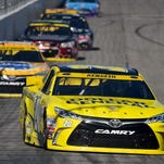 Sep 27, 2015; Loudon, NH, USA; NASCAR Sprint Cup Series driver Matt Kenseth (20) leads Kyle Busch (18) during the Sylvania 300 at New Hampshire Motor Speedway. Mandatory Credit: Jasen Vinlove-USA TODAY Sports