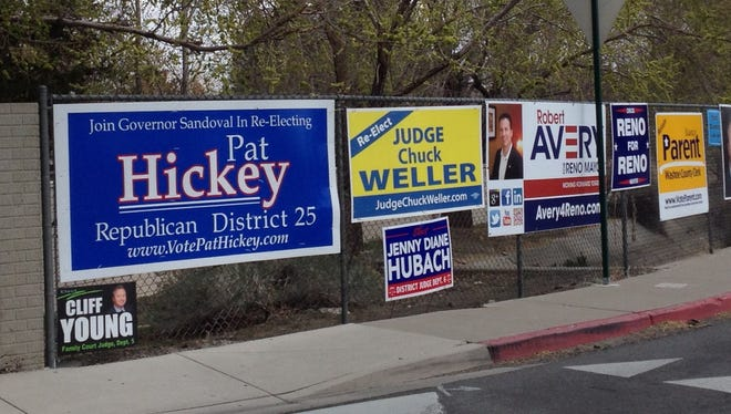 In 2014, campaign signs are shown in Reno before the primary election.