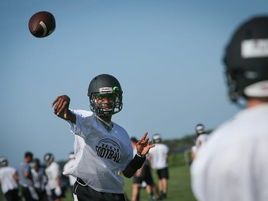 Sussex Tech's Tyzhir Morris throws during practice as News Journal high school sports reporter Brad Myers tours the state on the first day of football practice.