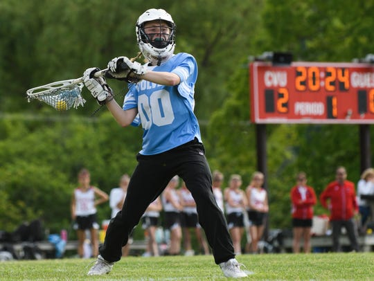 South Burlington goalie Claire Phillips (00) passes