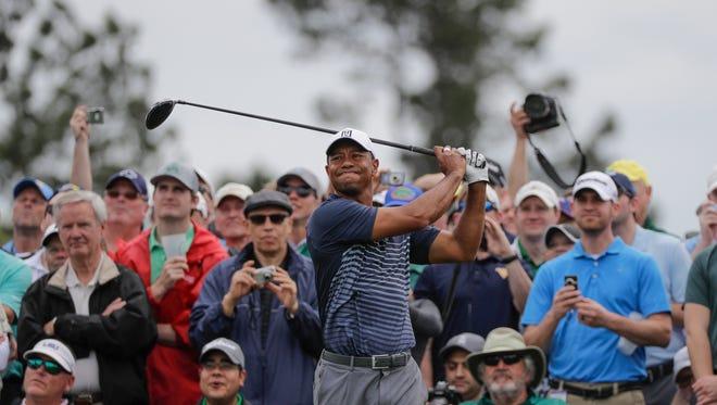 Tiger Woods hits on the eighth tee during a practice round for the Masters golf tournament Wednesday, April 4, 2018, in Augusta, Ga.