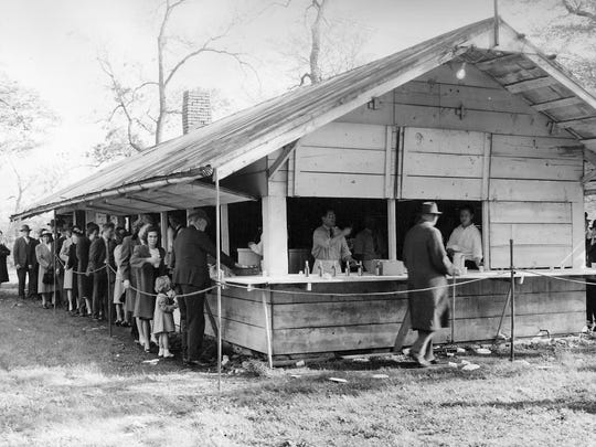 """Members of the local Moose Lodge were dressed in their """"Sunday best"""" as they stood in line for food at Moose Park."""