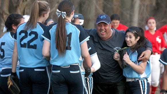 Ursuline softball coach John Pirone celebrates their