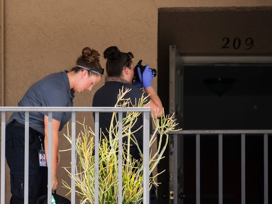Officers with the Cape Coral police department work the scene of a shooting at a Cape Coral apartment complex Thursday afternoon June 1, 2017.