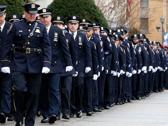 AP NYPD OFFICERS SHOT A USA NY