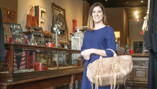 Star reporter Leslie Bailey models the Dee Dress by Jack for BB Dakota, $65, and a fringe handbag by Street Level, $42, from Niche boutique.