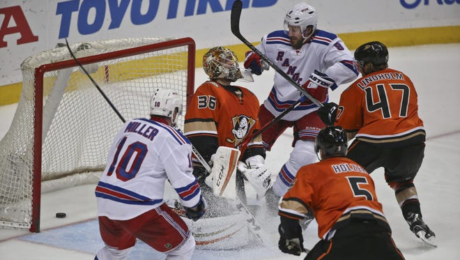 New York Rangers defenseman Kevin Klein, right, watches his shot slide past Anaheim Ducks goalie John Gibson for the game-winning goal during the third period of Wednesday night's game, won by the Rangers 2-1. Klein scored both of the Rangers' goals.