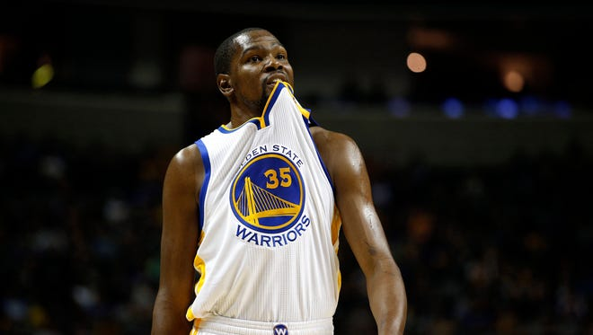 Oct 6, 2016; San Jose, CA, USA; Golden State Warriors forward Kevin Durant (35) bites his jersey against the Sacramento Kings in the first quarter at the SAP Center. Mandatory Credit: Cary Edmondson-USA TODAY Sports ORG XMIT: USATSI-325856 ORIG FILE ID:  20161006_pjc_se9_235.JPG