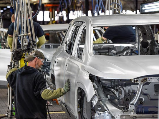 General Motors workers on the line Thursday, December 8, 2016 at the General Motors Spring Hill Manufacturing plant.