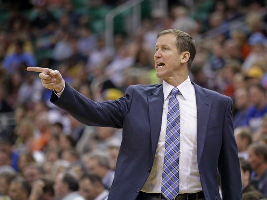 Portland Trail Blazers head coach Terry Stotts shouts to his team in the second quarter during an NBA preseason basketball game against the Utah Jazz Tuesday, Oct. 7, 2014, in Salt Lake City. (AP Photo/Rick Bowmer)