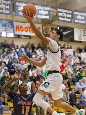 Chino Hills High School's Lonzo Ball scores against Thomas Jefferson on Friday during the Culligan City of Palms Classic at Bishop Verot High School in Fort Myers.