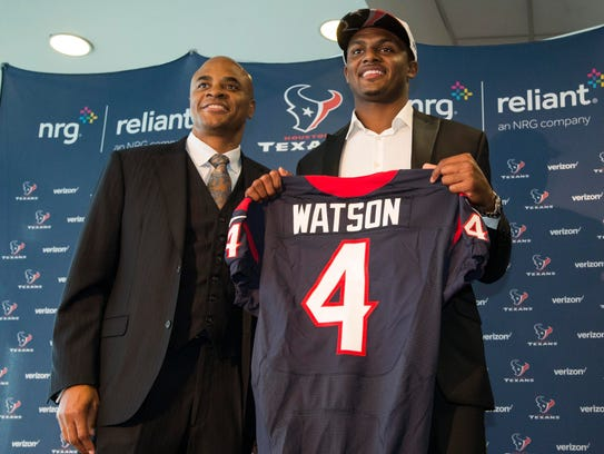 Houston Texans general manager Rick Smith (left) and