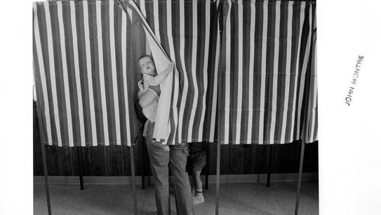 Eight-month-old Evan Williams hangs out the voting
