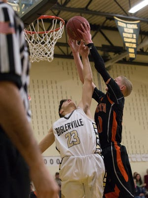 Susquenita's Chace Hare, right, goes up for a rebound against Biglerville's Cody Shaffer, Wednesday, Jan. 31, 2018. The Biglerville Canners beat the Susquenita Blackhawks, 70-39.