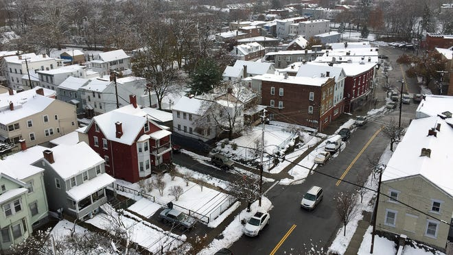 Snow blankets the Mount Carmel neighborhood of the City of Poughkeepsie on Thursday.
