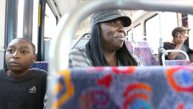 Jameelah Raby, 40, and her son Jordan Jones, 9  are on the refleX, a new express bus service on Gratiot that is a DDOT/SMART project that has  limited stops from Detroit to Mt. Clemens Monday, Sept. 12, 2016.