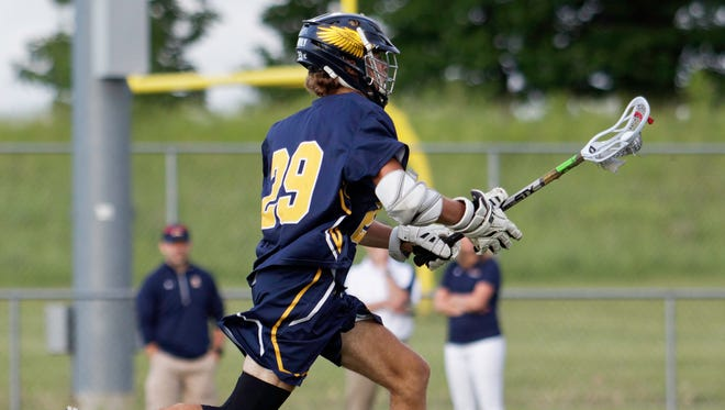 Hartland's Jake DeYoung scored six seconds into the game and won 21 of 27 faceoffs in a 19-7 victory over Brighton in the state Division 1 lacrosse quarterfinals on Friday, June 1, 2018.