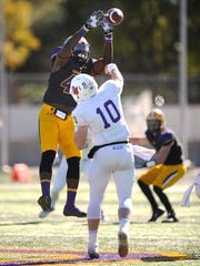 Hardin-Simmons defensive end Donavon Hailey (45) pressures Linfield quarterback Sam Riddle (10) as he throws a pass during the first quarter of the Cowboys' 24-10 loss in the first round of the NCAA Division III playoffs on Saturday, Nov. 19, 2016, at HSU's Shelton Stadium.