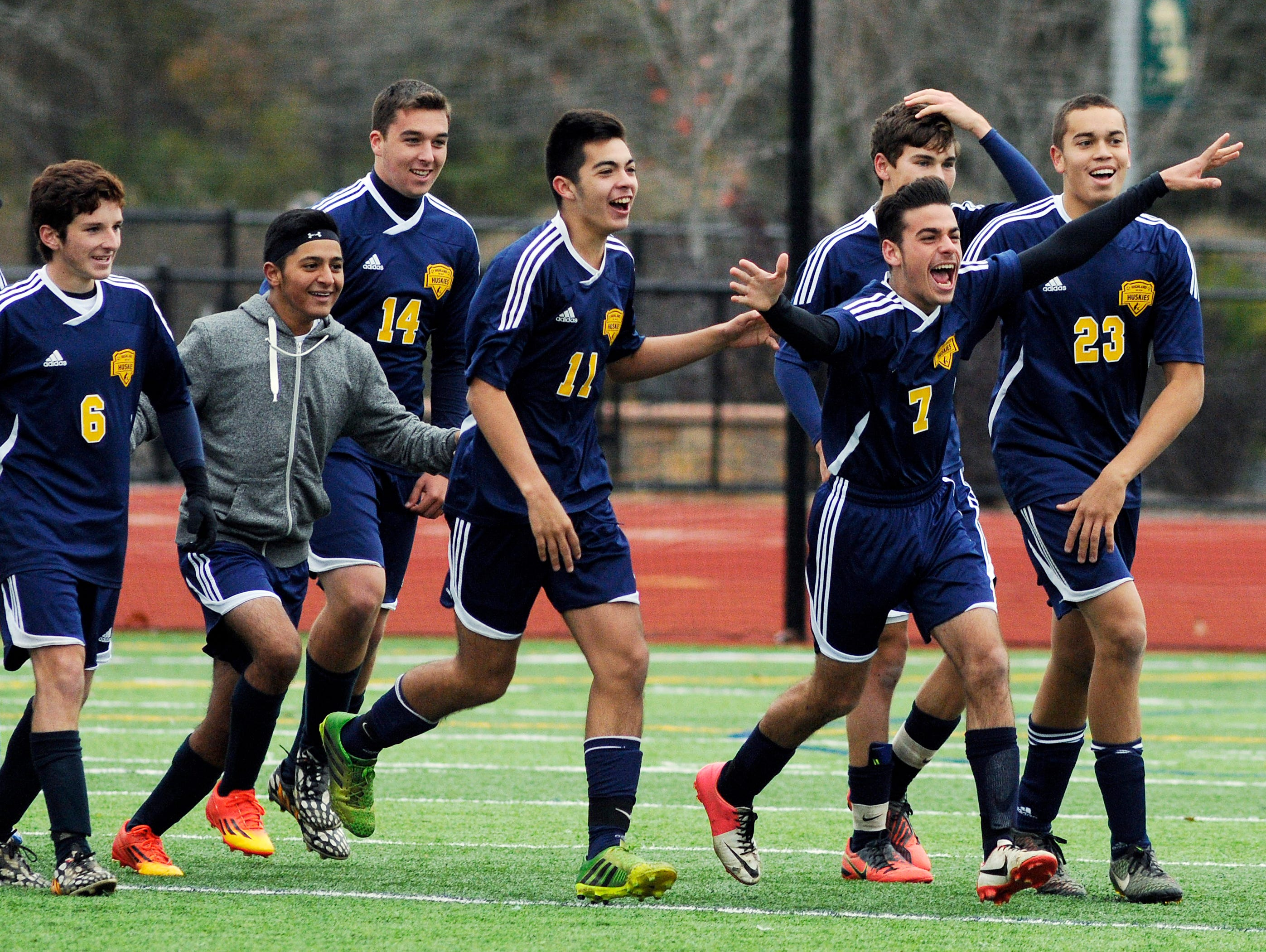 The Highland High School soccer team reacts after defeating Onteora for the Section 9 Class B championship on Nov. 1, 2014 in Hyde Park.