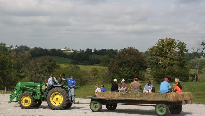 Hayrides were the most popular form of transportation during the Kenton County Farm Tour in 2014. This one is at Honey Locust Farm in south Kenton.
