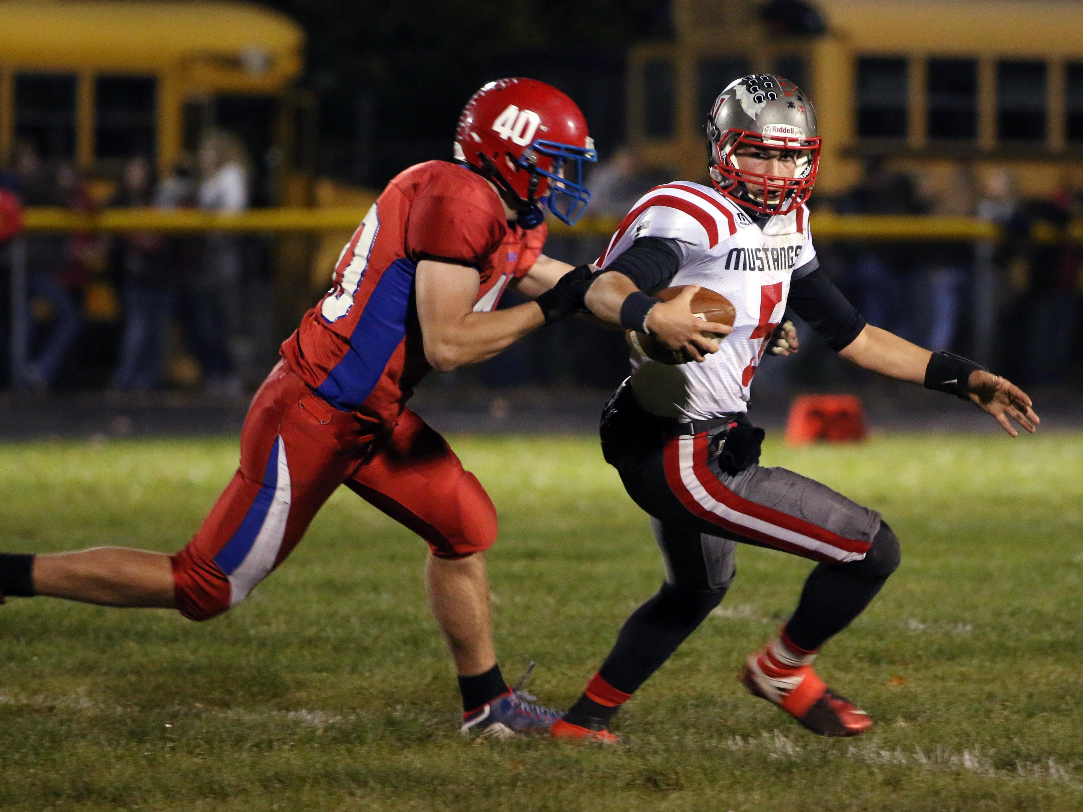 Zane Trace's Aiden Place chases down Westfall's Matt Jude during conference play earlier this season. Place led the area with 13 sacks.