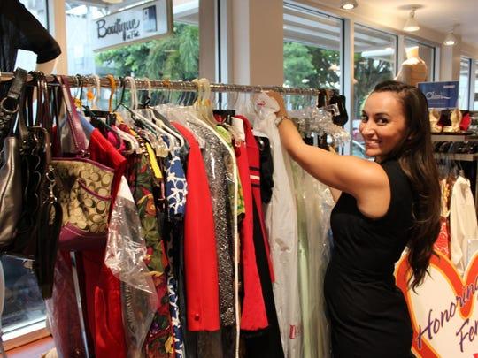 1. Margo Brewster organizes donated dresses