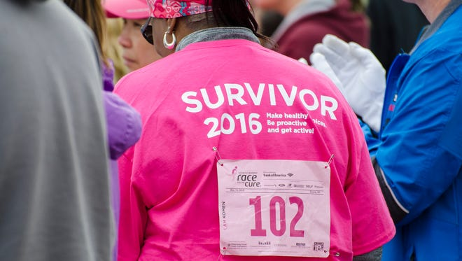 A breast cancer survivor  takes part in the 2016 Twin Tiers Komen Race for the Cure.