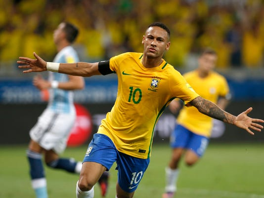 FILE - In this Nov. 10, 2016 file photo, Brazil's Neymar celebrates after scoring his side's second goal against Argentina during a 2018 World Cup qualifying soccer match in Belo Horizonte, Brazil. Brazil's national soccer team is the first to qualify for next year's World Cup. Despite the success, the sporting scene at home is littered with bribes and corruption linked to the World Cup and last year's Rio de Janeiro Olympics.  (AP Photo/Leo Correa, File)