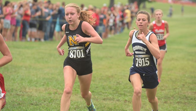 Northmor's Kristen Duryea runs to the finish at the Galion Cross Country Festival earlier this season. The Golden Knights won the Mid Ohio Athletic Conference Blue Division girls title and enter Saturday's Division III district race at Watkins Memorial as one of the favorites.