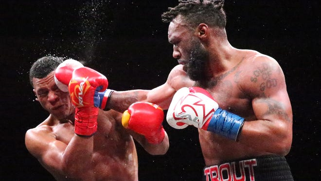 Austin Trout, right, lands a punch at Juan De Angel of Barranquilla, Colombia, during their bout Saturday night at the Don Haskins Center. Trout won by unanimous decision.
